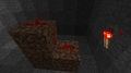 Redstone traveling up one block.png