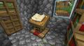 Um atril segurando um livro e pena