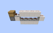A 1-block wide setup that will activate a dispenser once a beehive is ready.