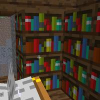 Чорні букви алфавіту вилітають з книжної полиці(видно на червоній книжці).