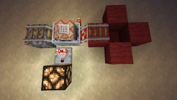 A minecart command block testing the block in the red bucket with air.png