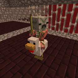 Ребёнок зомби-свиночеловек на курице.png