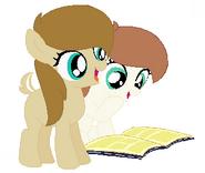 Julie y Cuca leyendo By Tigra