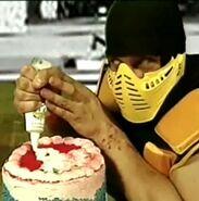 Scorpion baking a cake