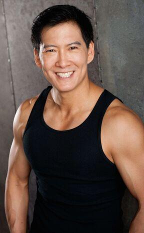Vic Chao smiling tank top.jpg
