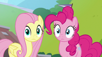 Fluttershy and Pinkie hear the music start S9E15