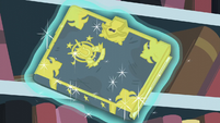 Trotter's Tome of Reliquary levitated out of the bookshelf S6E2