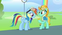 Lightning Dust showing Rainbow her badge S3E7