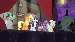 Applejack on stage talking to the audience S5E16.png