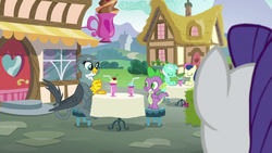 Rarity looking at Spike and Gabby hanging out at Ponyville Cafe S9E19.png
