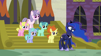Princess Luna poses awkwardly with school ponies S7E10