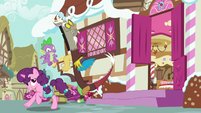 Sugar Belle runs past Spike and Discord S9E23