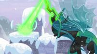 Queen Chrysalis blasting a snowy pillar S9E24