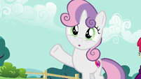 Sweetie Belle waving her hoof S5E19