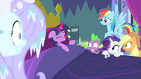 Twilight Sparkle holding a remedy book MLPS2