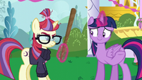 Twilight offering a pinata stick to Moon Dancer S5E12