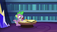 Spike writing a letter to Princess Celestia S6E15