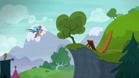 Rainbow carries Scootaloo to a small cliff S6E7