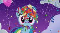 Rainbow covered in confetti and streamers S6E7