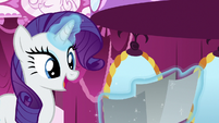 Rarity looking at Miss Pommel's photographs S7E9