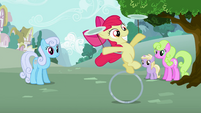 Apple Bloom on her ring while balancing plates S2E06