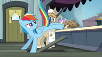 Rainbow kicking paper bags over the counter S4E22