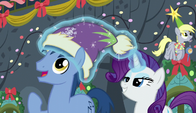 Rarity puts a hat on Noteworthy's head S6E8