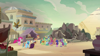 Rainbow, Pinkie, and A. K. enter the village square S7E18
