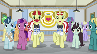 Flim and Flam lead a marching line S8E16