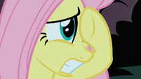 Fluttershy tries to cover her view of the Cockatrice S1E17