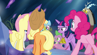 Mane 6, Spike and Discord gathering around the chest S4E26
