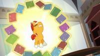 Books levitate in a circle around Sunburst S6E1
