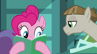 Pinkie Pie looking through Maud's party file S8E3