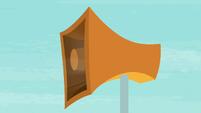 Loudspeaker blaring with sound S9E15
