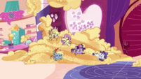 Wide view of ponies in giant pile of batter PLS1E1b