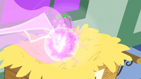 Baby Spike being shot by a beam of magic S1E23