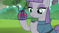 Maud holding rock pouch and Boulder S6E3