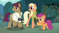 Scootaloo pointing into the forest S9E12