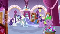 Spike eats gems while Rarity talks to Twilight S9E26
