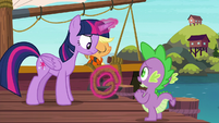 Twilight unties the boat's mooring line S6E22