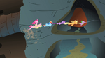 Pinkie riding Fluttershy as they are being dragged down into the caves system S1E19