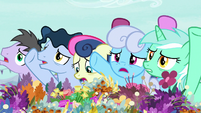 Ponies clamoring agitatedly at the flower trio S7E19