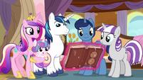 Twilight's family looks at the almanac S7E22