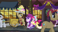 Dr. Hooves holding up a large tray of sweets S6E8