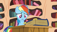 Rainbow looking at the book S4E21