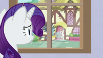 Rarity watches Spike and Gabby out the window S9E19
