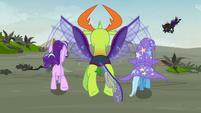 Starlight, Trixie, and Thorax run toward the ridge S7E17