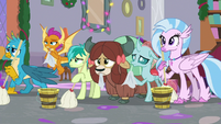 Young Six holding cleaning supplies S8E16