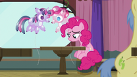 Pinkie Pie sits at the far corner table S9E16