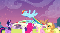 Rainbow being launched up by her friends S4E12